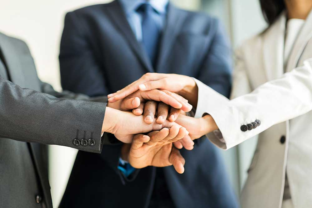 business people huddle