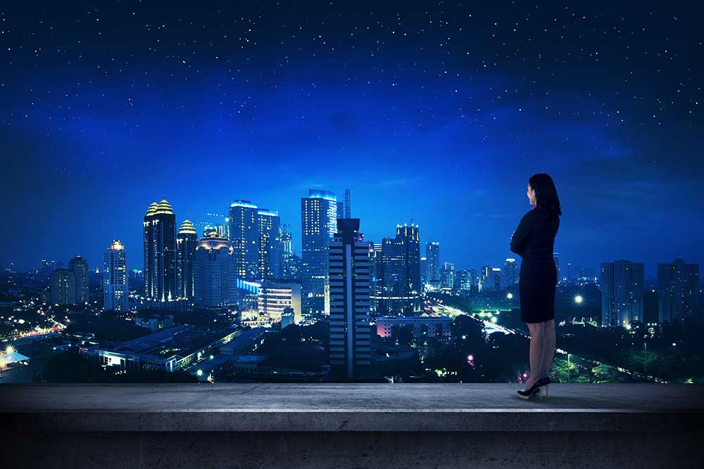 Business person looking out over cityscape