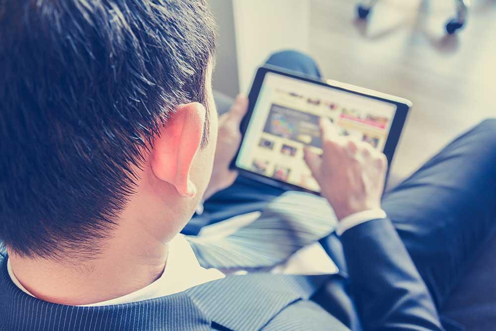 Businessman on tablet