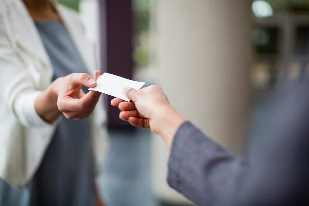 Handing a colleague a business card