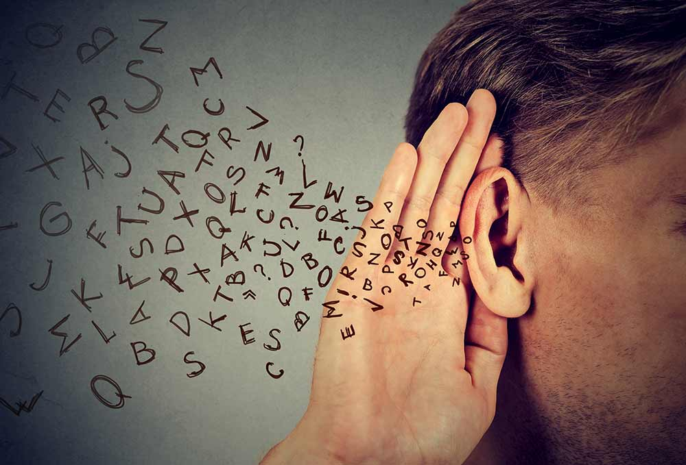Man listening with letters flying into his ear