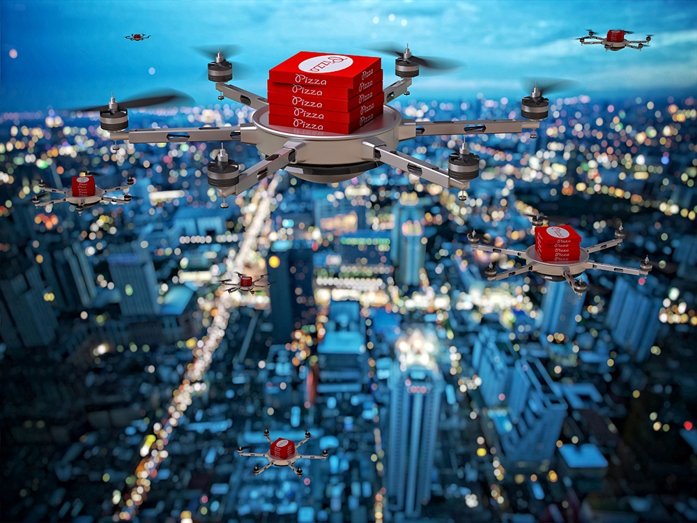 drones delivering pizzas in city sky