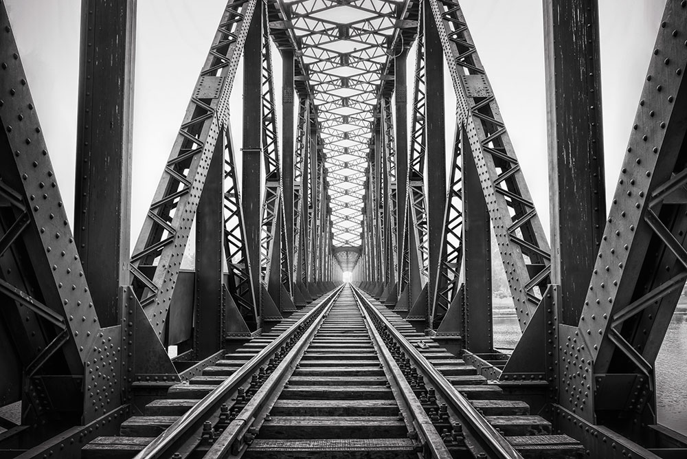 black and white train bridge