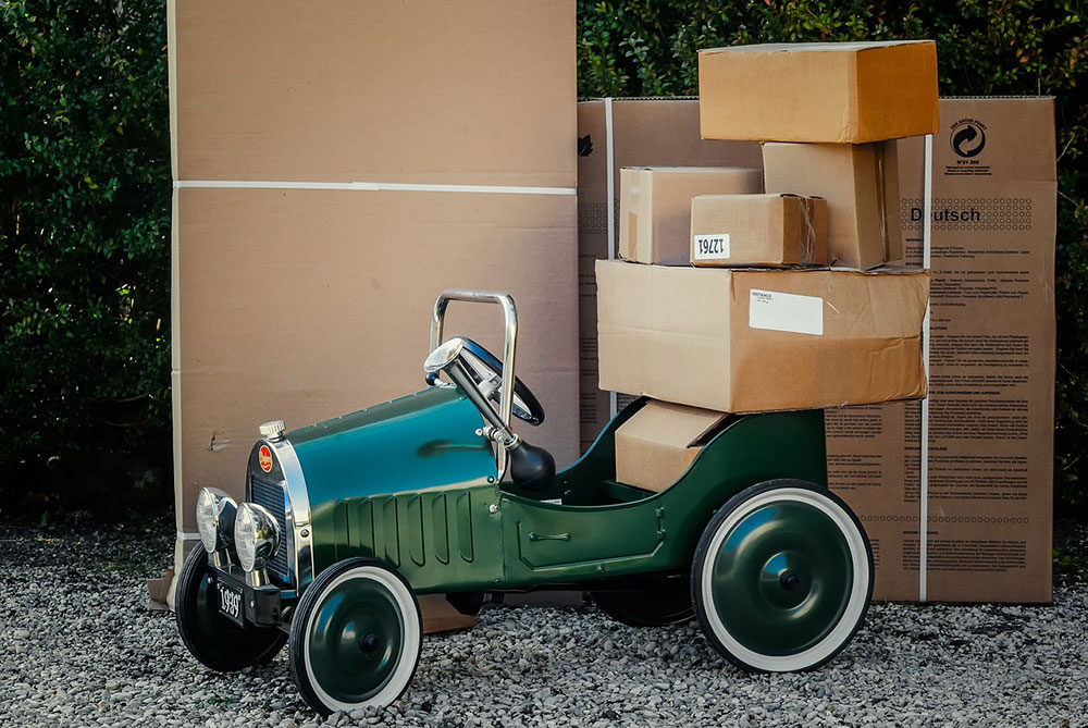 Packages piled on a green jalopy