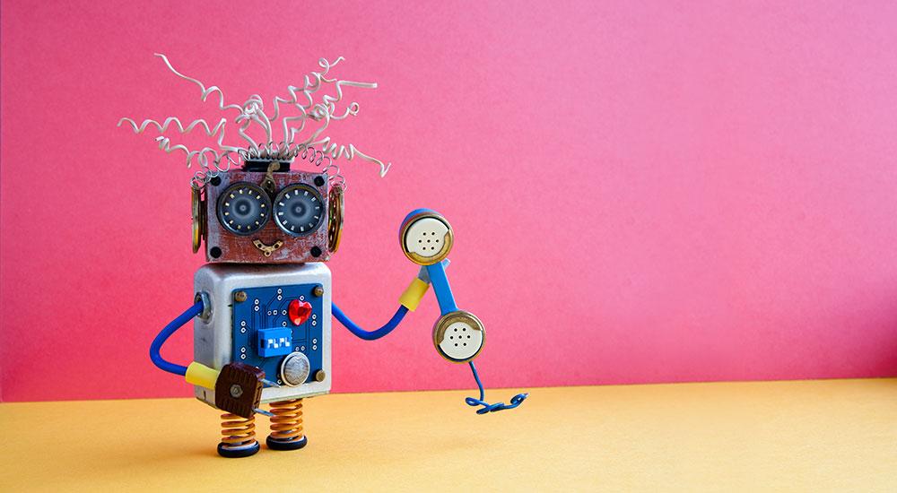 cute robot holding telephone