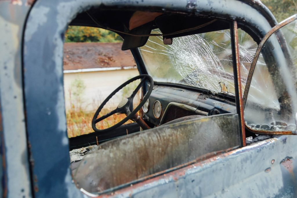 old truck with broken windshield
