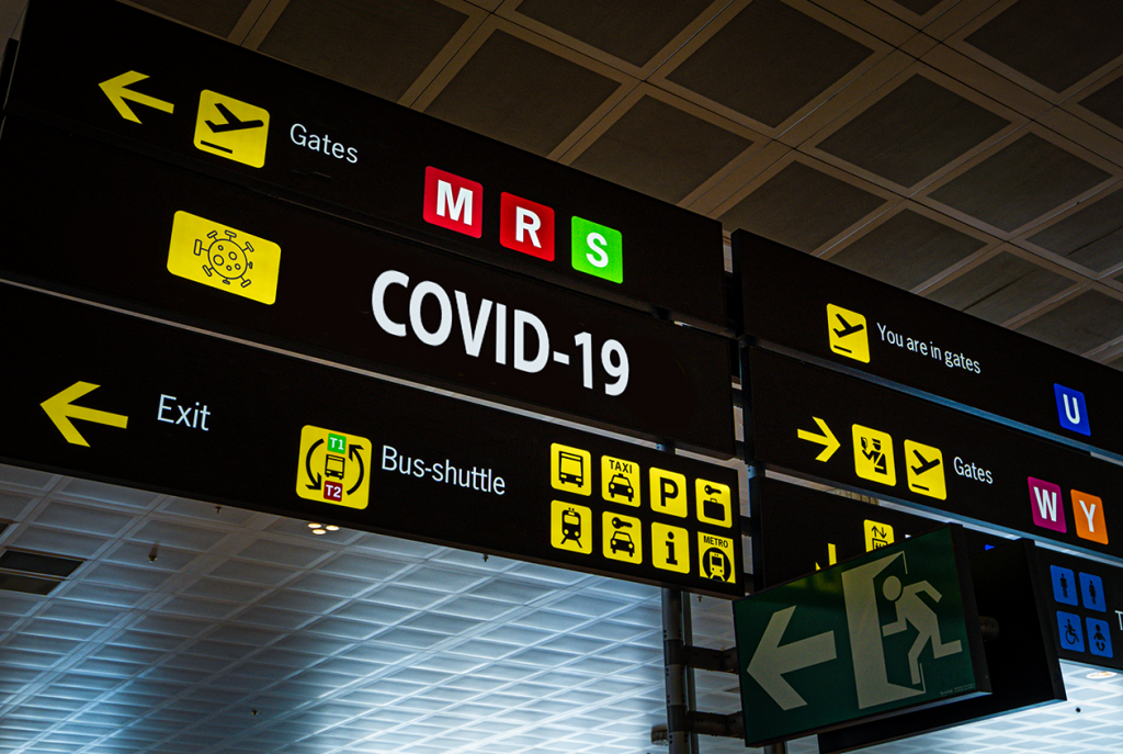Airport sign showing COVID-19 gate