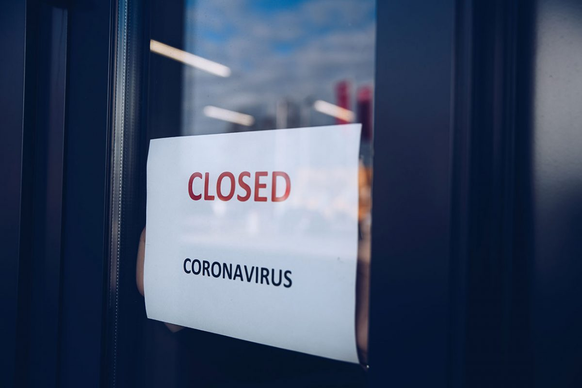 Closed Coronavirus sign on window of business