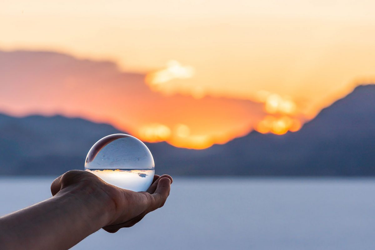 Crystal ball held in outstretched palm