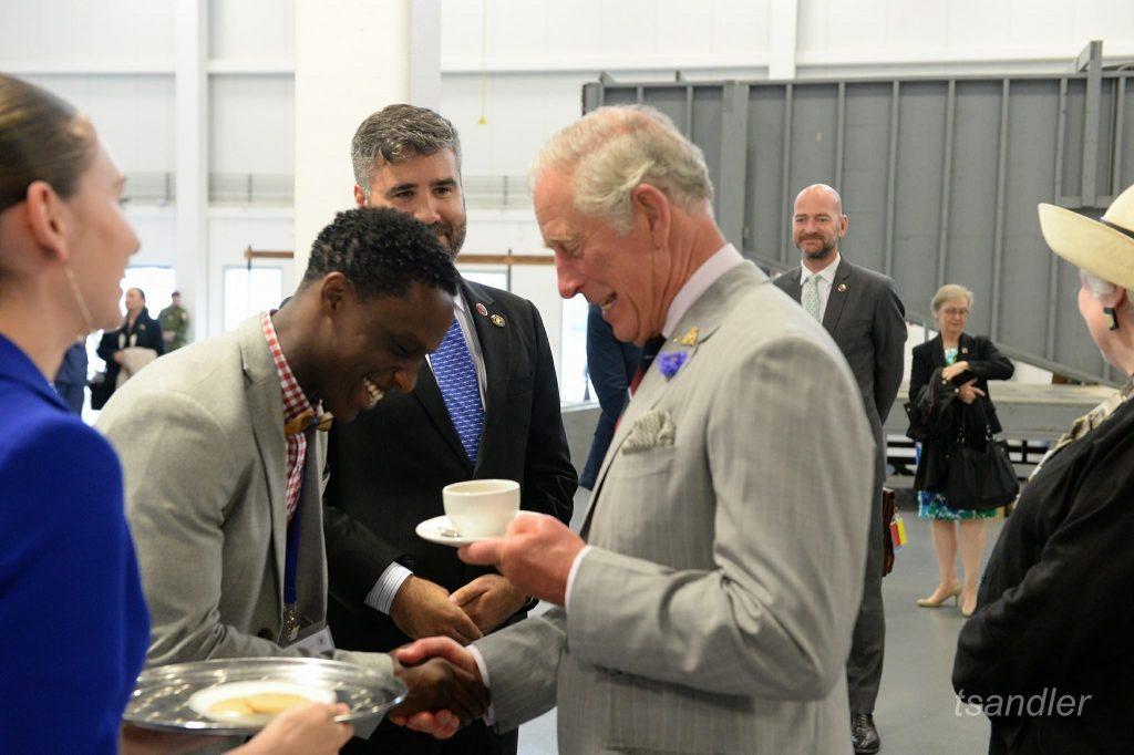 Daniel serving tea to HRH - Prince Charles