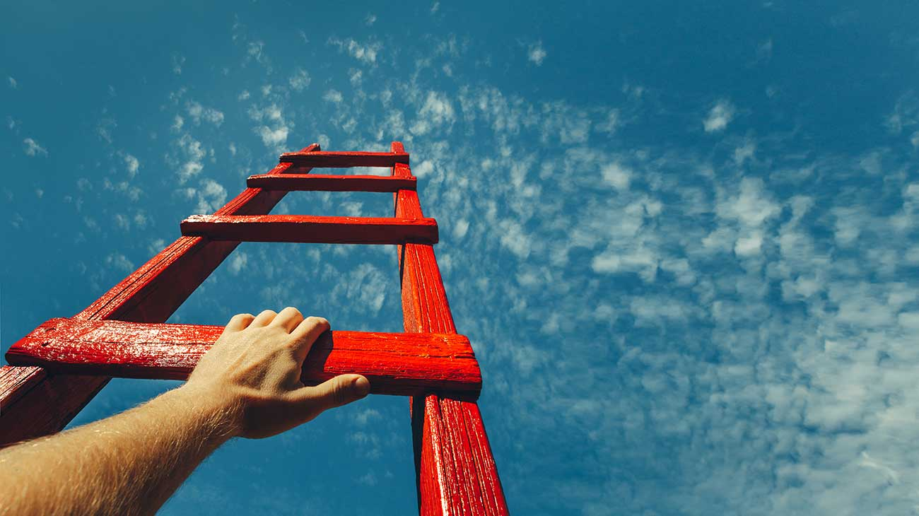 ladder reaching into the sky, hand on bottom rung
