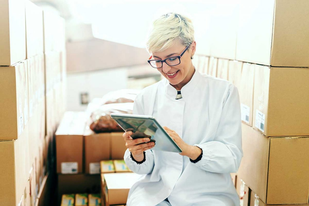 woman in warehouse with tablet