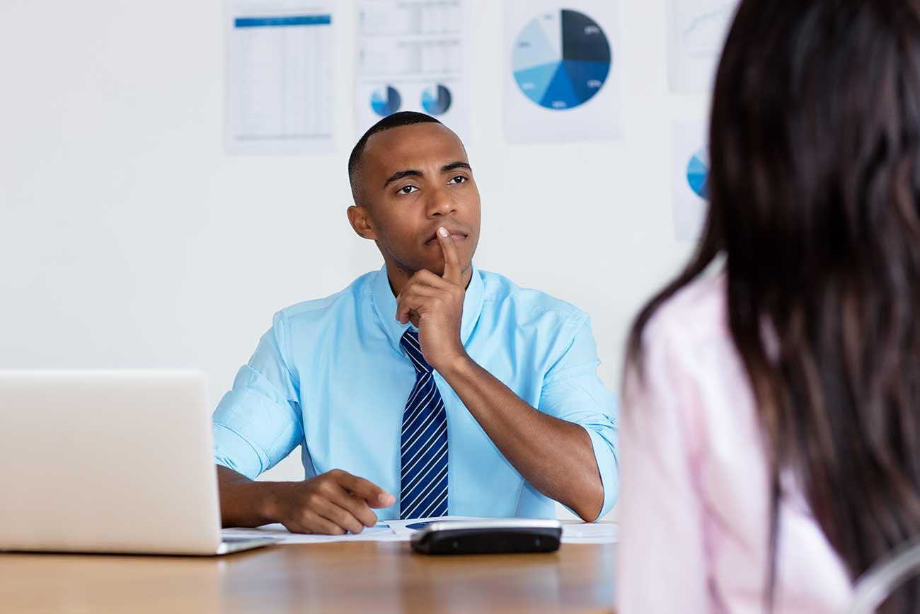 Businessman assessing colleague